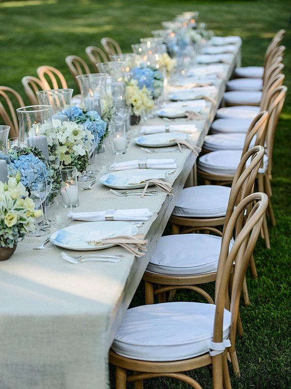 long table setup wedding reception%0A Long tables decorated with glass hurricanes  white and blue hydrangeas and  linen dinner menus hand