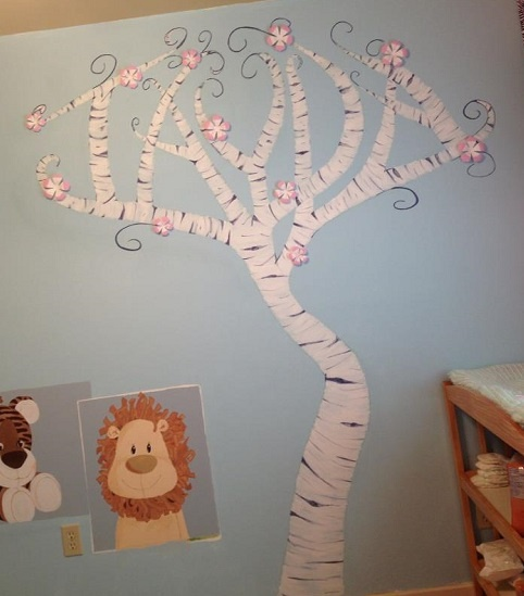 Wrote her name in a tree and painted it onto the wall, bought 3D flowers dipped them into pink paint and stuck them on the wall.    Jayda nursery tree mural