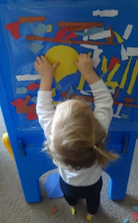 Abstract toddler art with sticky paper and paper scraps