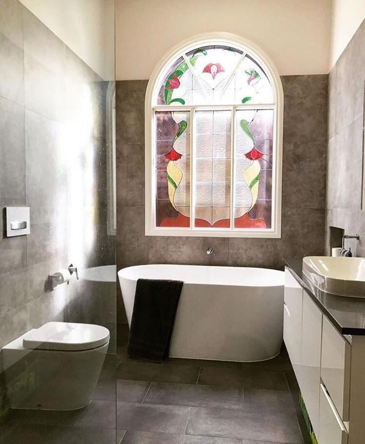 Beautiful bathroom in Essendon, VIC by PB Bathrooms. A compact bath like the Posh Solus shown here means even a small space can have a touch of luxe.