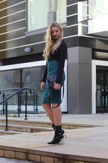 Get this look: http://lb.nu/look/7975050  More looks by Laura Rogan: http://lb.nu/laurarogan  Items in this look:  Primark Roll Neck, Missguided Skirt, Primark Bag, Ego Boots   #chic