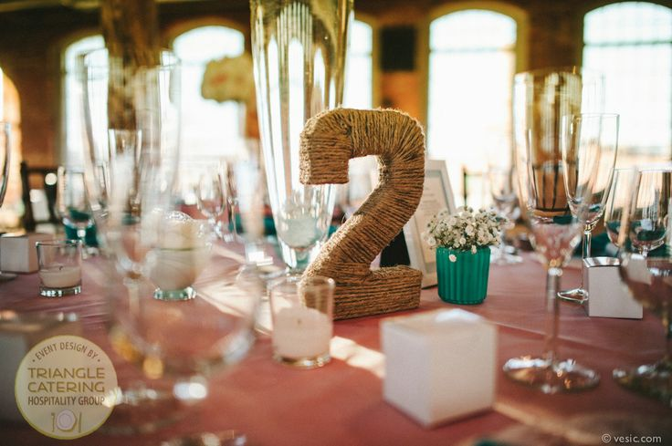 Rustic twine-wrapped table numbers at The Cotton Room in Durham, NC #TriangleWeddings (photo courtesy of Vesic Photography)