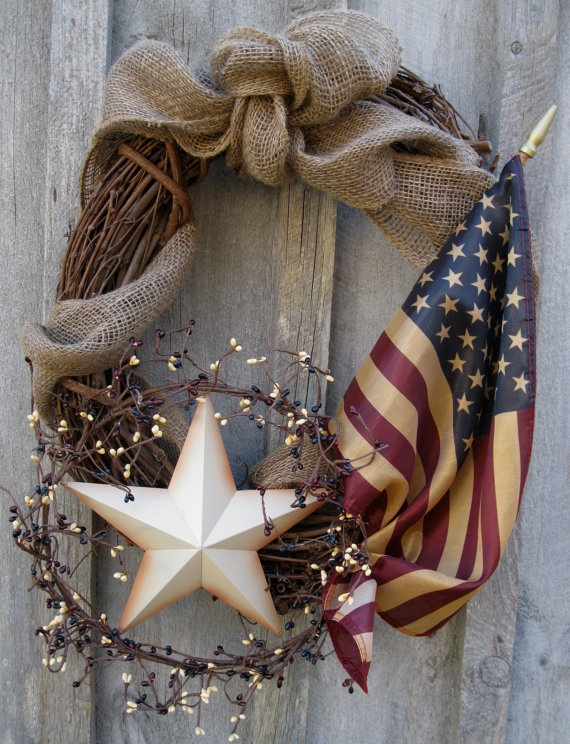love this wreath..simply made with burlap bow, flag and metal star (make a pipberry circle around star)...