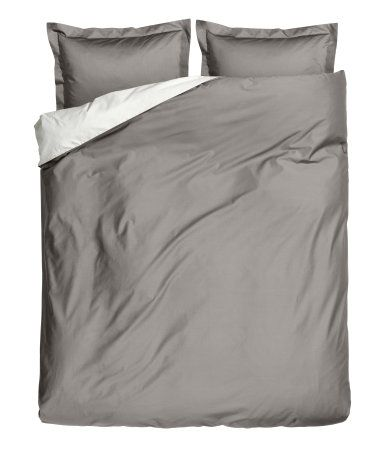 Satin Duvet Cover from H&M. Combine it with some different colors and textures to dress up the bed.