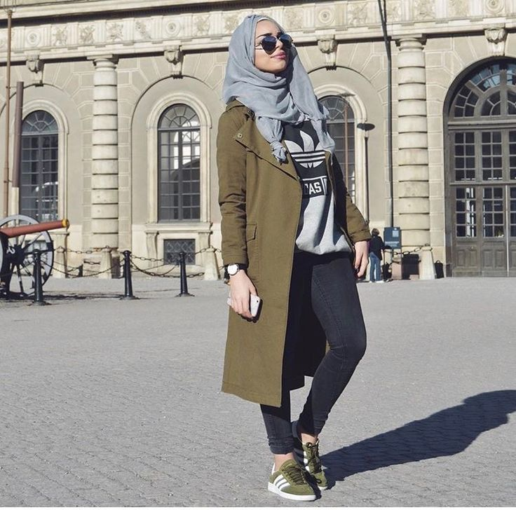gray scarf/hijab + gray Adidas sweatshirt + skinny jeans + olive green long coat + olive green Adidas Campus sneakers