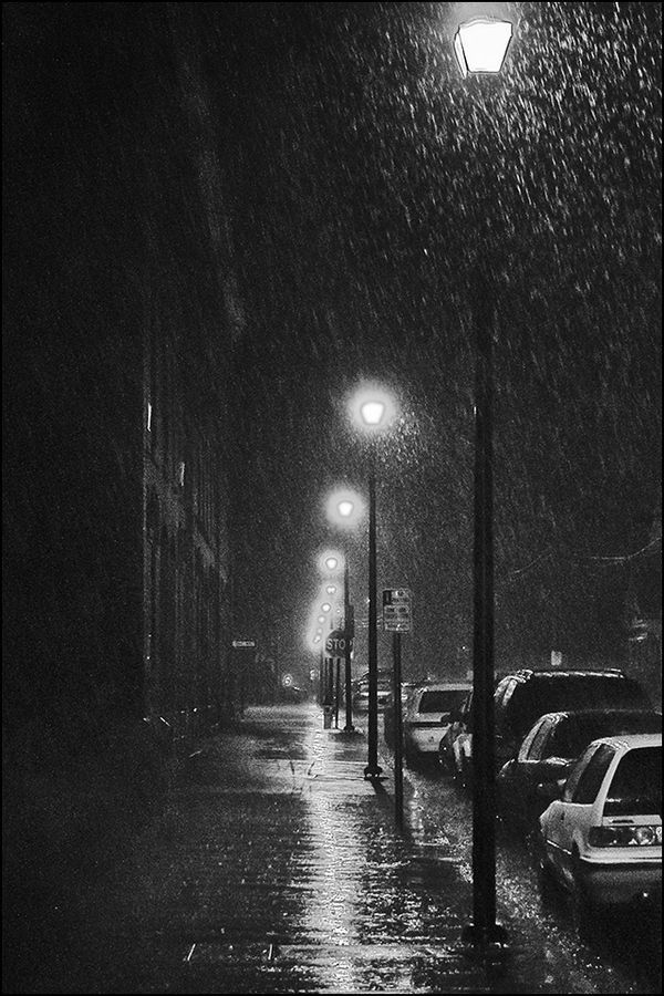 Rain at night....I rather like seeing the rain drops fall highlighted by street lamps