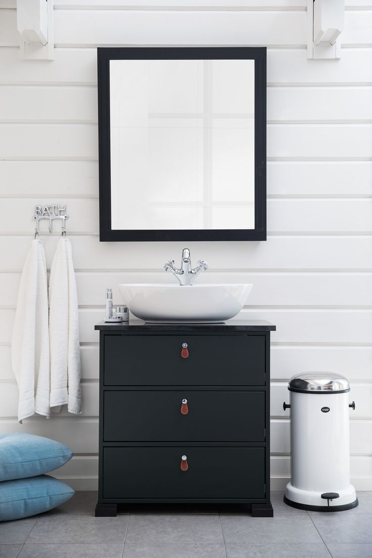 SVEA vanity unit. SVEA granite work top ebony black. ELLIPSE porcelain washbasin. CANOVA washbasin mixer.