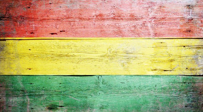 #Flag of Bolivia  Flag of Bolivia painted on grungy wood plank background