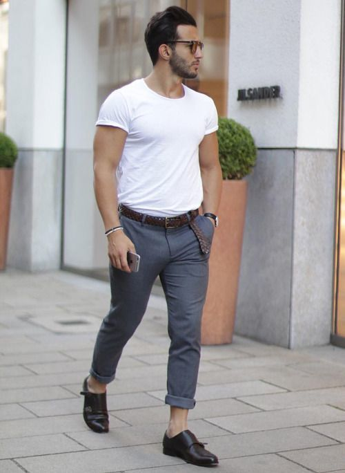 Marry a white crew-neck tee with grey chinos to get a laid-back yet stylish look. Feeling inventive? Complement your outfit with black leather double monks.   Shop this look on Lookastic: https://lookastic.com/men/looks/white-crew-neck-t-shirt-grey-chinos-black-double-monks/18334   — White Crew-neck T-shirt  — Dark Brown Woven Leather Belt  — Grey Chinos  — Black Leather Double Monks