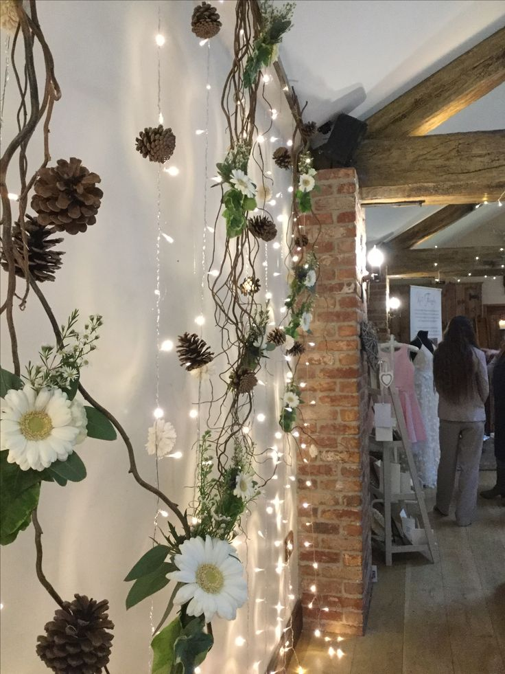 Floral and twig back drop - stunning #weddings #flowers #twigs #lights #backdrop