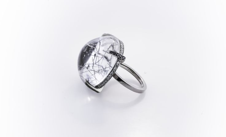 Rutilated quartz globe ring in white gold and accented by black & white diamonds.