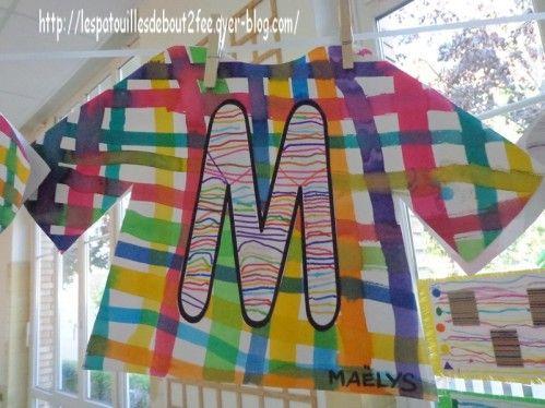 Des traits pour décorer son initiale ( trouvées sur le site de Moustache - Alphabet) Lettres découpées puis collées sur une chemise décorée d'un quadrillage à l'encre ( quadrillage fait sur une feuille rectangulaire puis découpée ensuite)