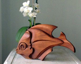 Einzigartige Holzskulpturen inspiriert von der Yin und