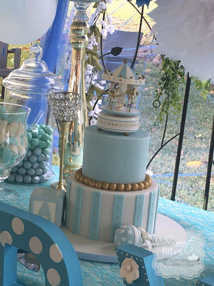 gold and blue baby shower cake