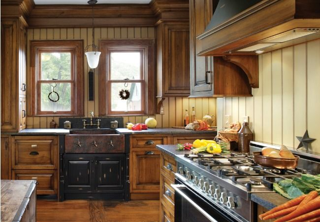 A turn of the century kitchen features modern standards for Period kitchen design