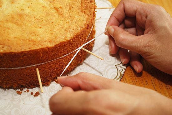 Cut cake layers using toothpicks and dental floss.