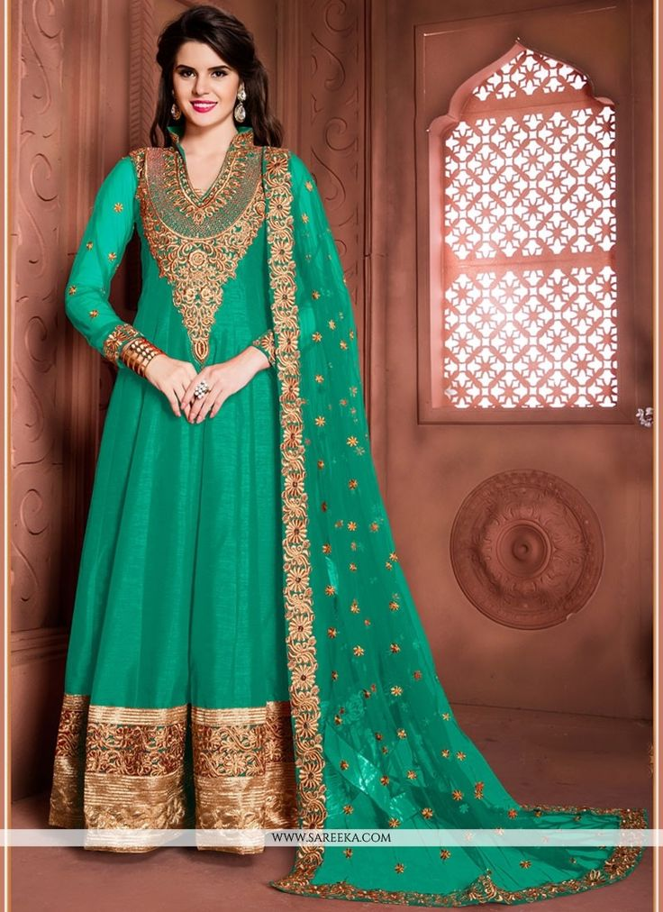 Create a smoldering impact by this sea green banglori silk designer floor length suit. This attire is encrafted with embroidered, patch border and zari work. Comes with matching bottom and dupatta. (S...