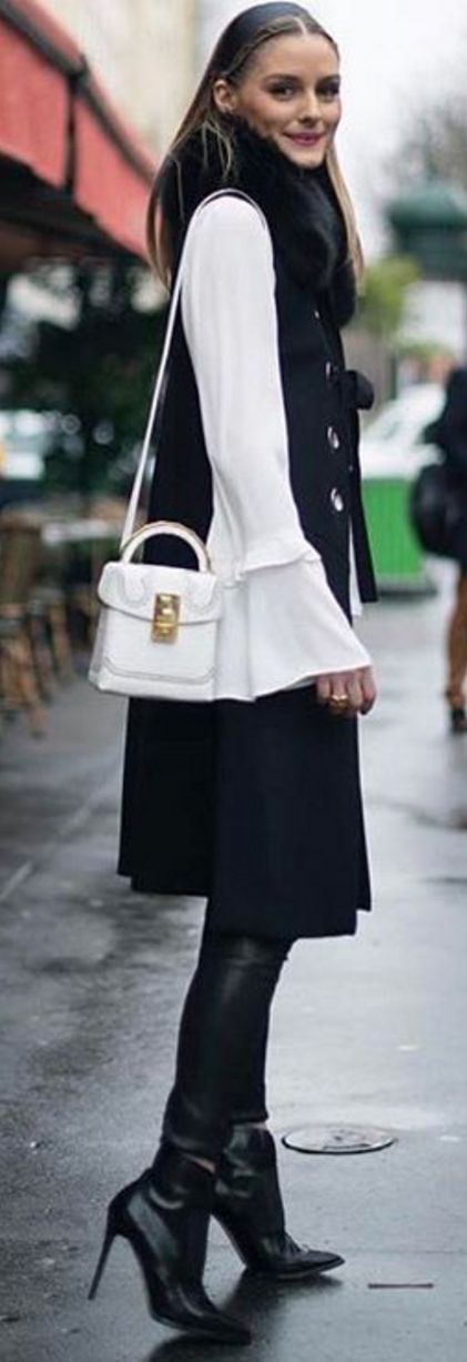 Who made Olivia Palermo's white handbag, white belle sleeve top, black vest, and black thigh high boots?