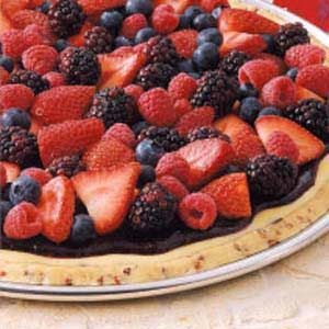 Brunch Berry Pizza Recipe -This beautiful berry-topped pizza tastes as good as it looks! It's impossible to resist the tender pecan short-bread crust, rich cream cheese layer, glossy berry topping and sprinkling of luscious fresh berries. It's so convenient to make the night before and serve the next morning. —Maria Schuster Wolf Point, Montana