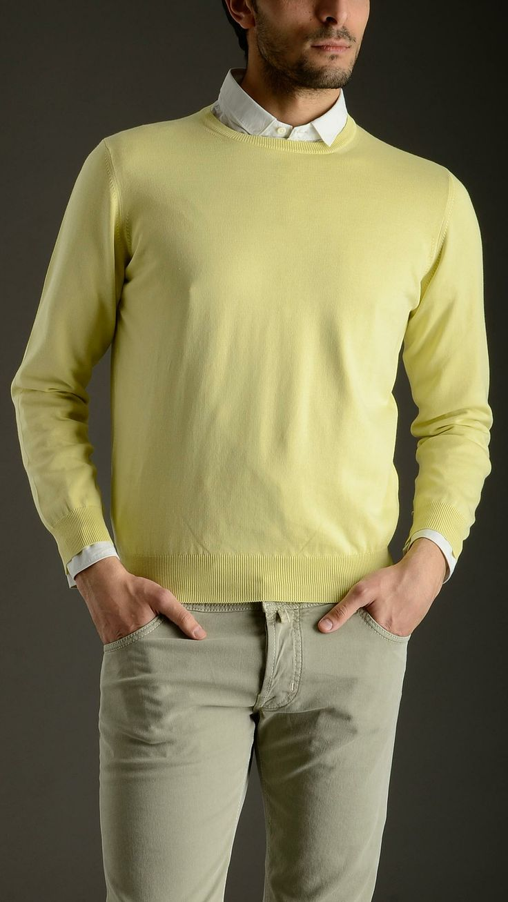Crewneck cotton yellow plained sweater characterized by ribbed cotton detail on the cuffs and on the bottom, from DELLA CIANA COLLECTION.