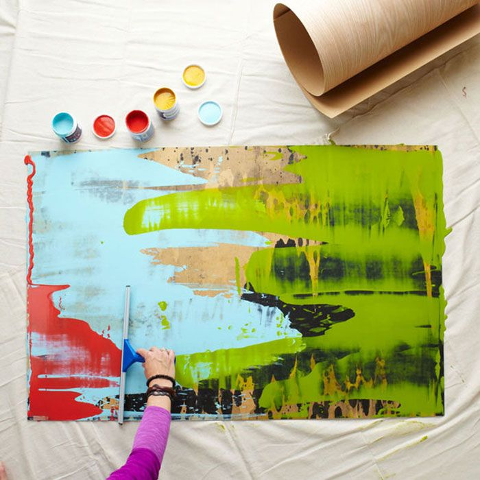 Use paint and a squeegee to make a colorful piece of artwork for a living room, bedroom, or hallway.