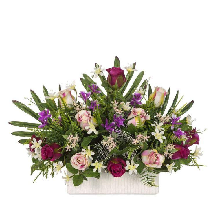 Jardinera Todos los Santos. Jardinera de cerámica para cementerio con flores artificiales. Rosas malva y bicolor flores y hojas de relleno. Plana. Alto 28 cms.