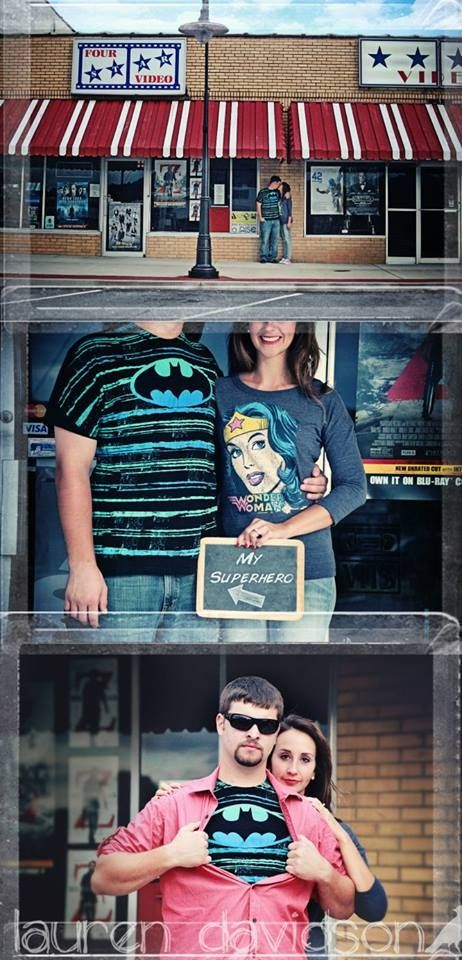 Urban, small town photos. Engagement pictures with buildings, stores, vintage video store, superhero shirts, chalkboard. Superhero themed engagement photo session. Ideas for engagement photo session. Pre-wedding photo shoot. Unique engagement photos, unique camera angles. My superhero on chalkboard photo prop. Lauren Davidson Photography.