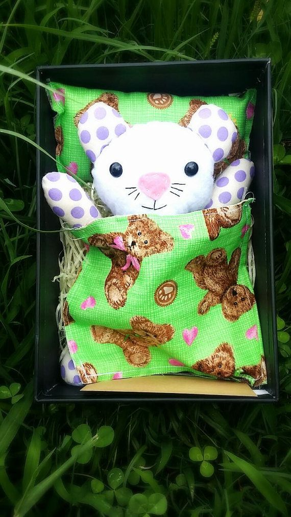 One of my adorable little handmade teddies in a box. Complete with bed and bedding. Comes with a vest and a birth certificate