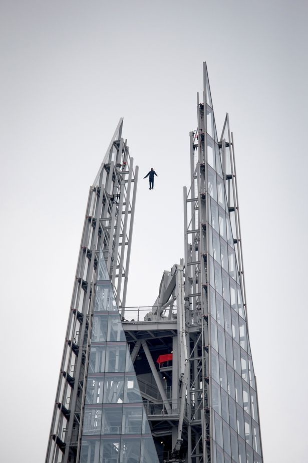 Stunning Stunt: Dynamo performs a levitating stunt at the top of The Shard