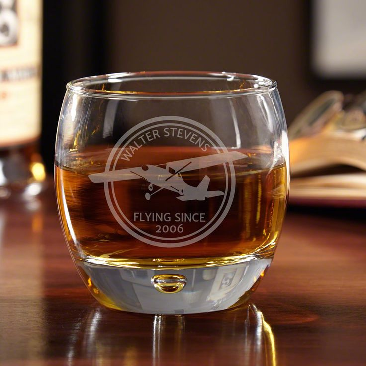 Becoming a pilot is a truly admirable feat. Celebrate his love for the skies with these dapper Aviator custom whiskey glasses.
