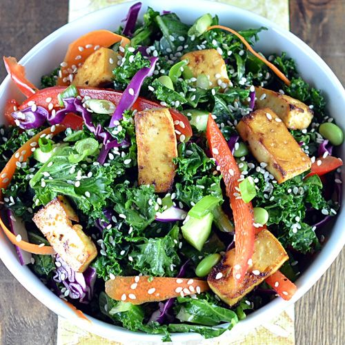 Asian Kale & Tofu Salad    This vegetarian dish offers a hefty dose of nutrients, thanks to leafy green kale. If you're not a fan of tofu, substitute for your favorite protein.