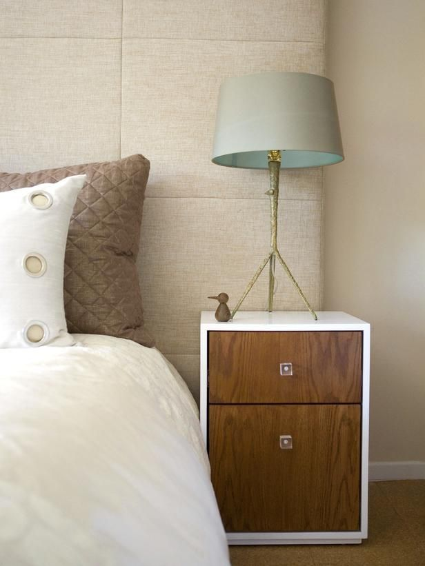 Chic Bedroom w cool tripod lamp.  That little duck is cute, too.