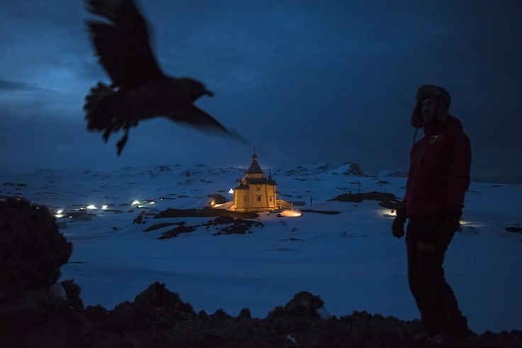 A Chilean scientist walks above the Russian Orthodox Church of the Holy Trinity on the Bellingshausen Russian Antarctic base.by Daniel Berehulak