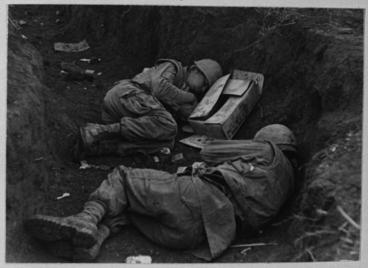 "todaysdocument: "" ""Two Marines sleep in the rain, mud, and cold of a trench line at Con Thien."" 10/02/1967 "" 87 - Combat - 1967 - October 2, 1967, 10/2/1967. File Unit: Divider/Subject - 87 - Combat -..."
