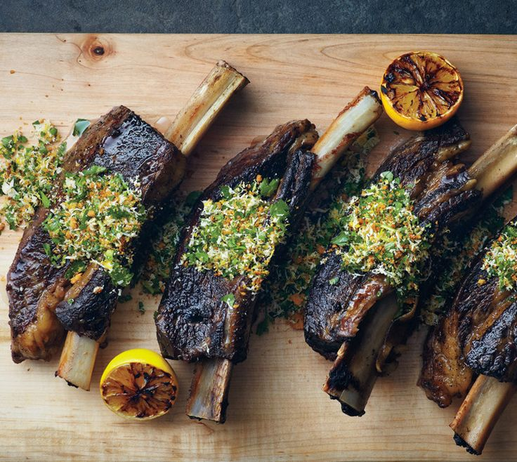 English short ribs are cut lengthwise along the bone, so the meat sits on top. With a day or two of notice, any butcher should be able to cut them to order.