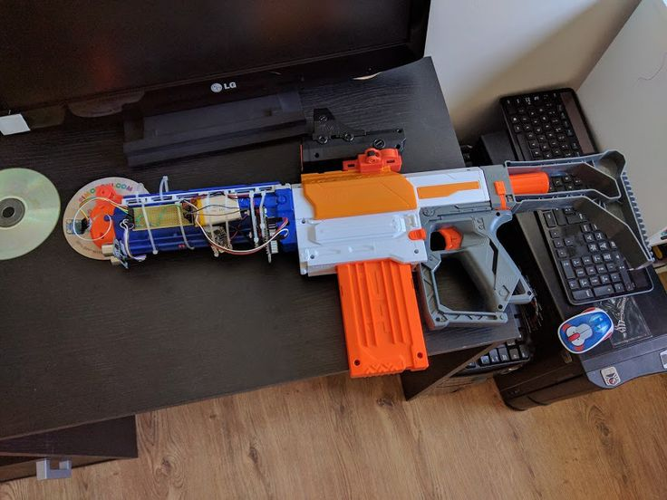 Michael Darby's newest project is a Nerf gun with added rangefinder and ammo counter, created with the help of a Pi, a Pimoroni Rainbow HAT, and sensors.