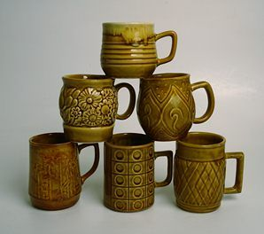 6x Mid Century Crown Lynn Coffee Cups with distinctive embossed design work in a gold glaze,