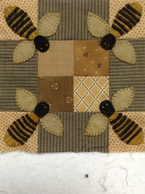 Bees at corners of block.  Timeless Traditions: New finishes......