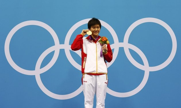 China's Ye Shiwen stands with her gold medal after setting a world record in the women's 400m individual medley during the London 2012 Olympic Games at the Aquatics Centre July 28, 2012. Ye made a new world record with a time of 4 minutes 28.43 seconds.