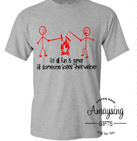 Mens Camping Shirt, Camping Shirt, Mens Shirt, Mens Funny Tshirt, Funny TShirt, Stick Figure Shirts, Stick Figure, Camping Shirt For Men,Gifts For Men, Fall T Shirt, All Fun And Games  Its all fun and games until someone looses their wiener tshirt is about the most funniest campfire t-shirt around. ​It is perfect for those campfire nights. We all know the heartbreak when the hotdog falls off the stick. T-shirt is 100% Cotton Jersey knit and is hand embellished with artists design in heat…