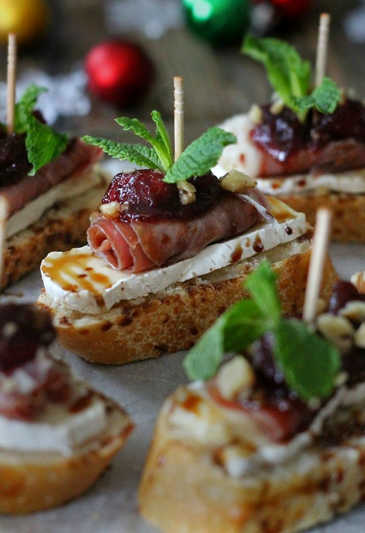 Brie, cranberry, and prosciutto crostini with balsamic glaze