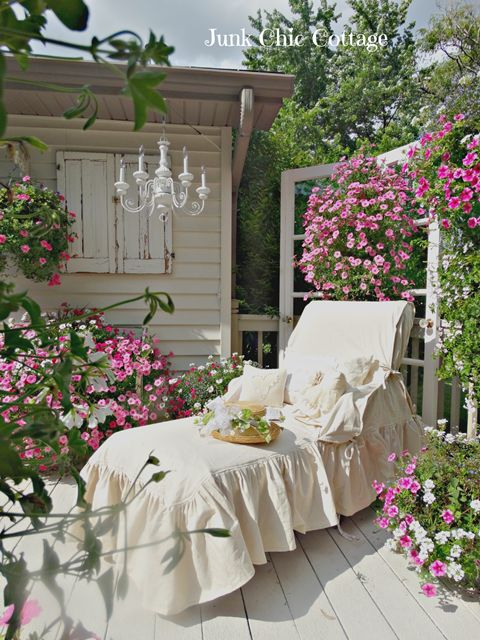 gorgeous garden lounger slipcover adds to the romance of petunias in the cottage garden
