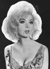 I saw Holly White on stage was in the early 1970s at Finocchios in San Francisco.   I was mesmerized by the image of this beautiful female impressionist.