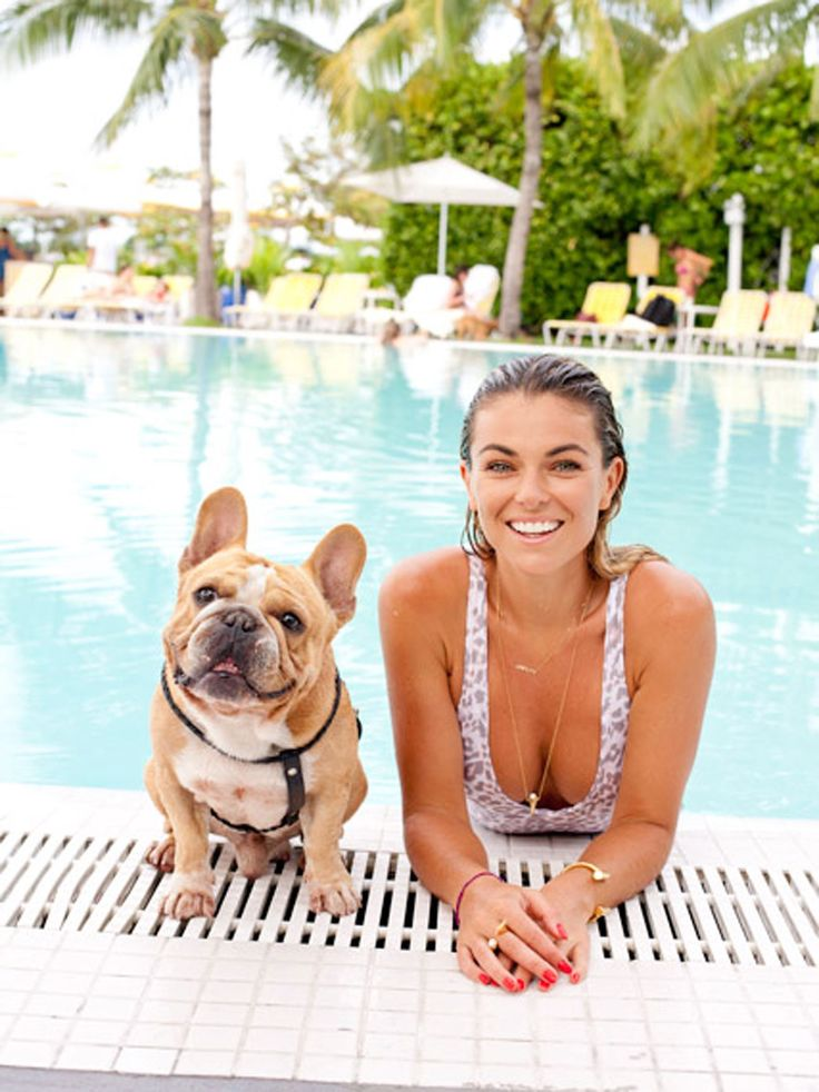 "Say cheese! ""Graceland"" actress Serinda Swan was all smiles while posing for a picture with her dog on vacation in Miami on Feb. 6, 2015. Don't forget your SPF."