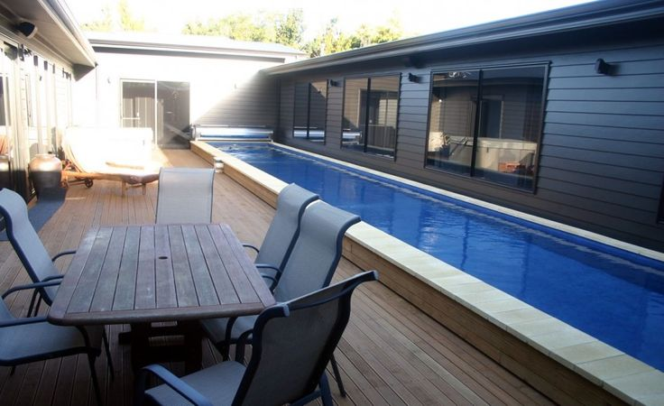 swimming pool Outdoor Wooden Dining Table Beside The Swimming Lap Pool Design Ideas How to build lap pools into your house