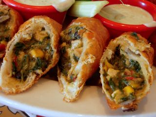 Southwest Eggrolls  Possible Variation: leave out the chicken, use egg roll wrappers, do not freeze overnight and bake in oven at 425 for 15 minutes. Spray cookie sheet, then spray tops of egg rolls. Turn over once during cooking.