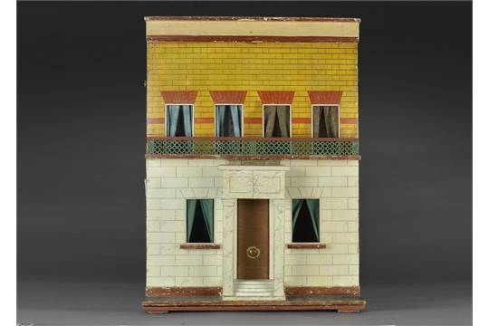 A Silber & Fleming type box back dolls' house, with stone and yellow brick painted façade, red br