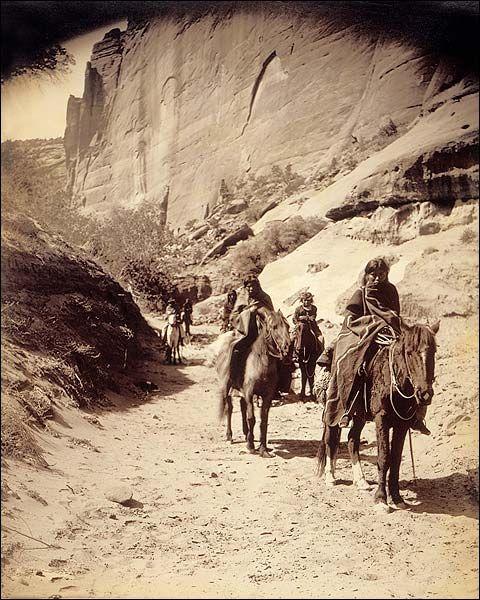 Navajo Indian Band Edward S. Curtis 1904 candid photo of a band of horse mounted Navajo passing through Cañon.