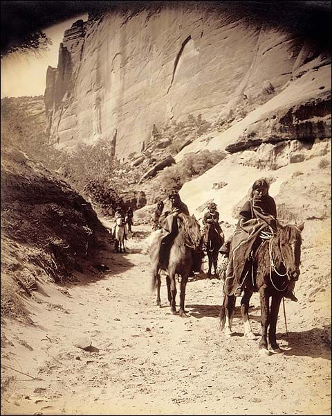 Navajo Indian Band Edward S. Curtis 1904 candid photo of a band of horse mounted Navajo passing through Cañon.