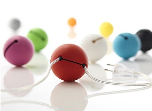 "The tennis sized ball can hide (or ""swallow"") up to 5 feet of cable, cutting down on all that extraneous cordage that most of us have behind/around our desks and media centers."